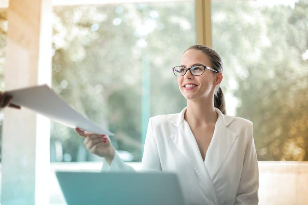 woman delivering commercial appraisal report